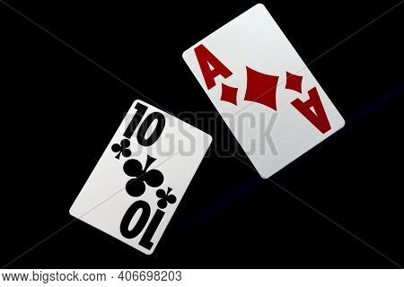 Casino BlackJack playing cards over black background