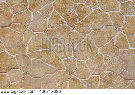 The Texture And Background Of The Wall Is Made Of Stone Tiles Of Beige-golden Limestone In The Form