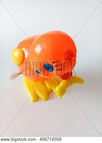 Plastic Clockwork Toy Chicken On White Background