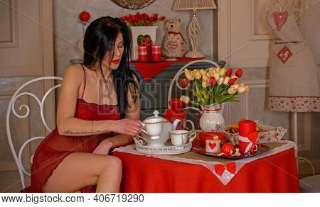 Seductive Woman Wearing Sexy Clothes At Home. Attractive Sensual Young Girl . Female Celebrate Valen