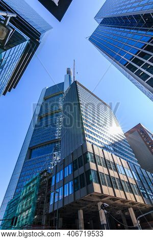 Looking Up Along High-rise Buildings. Blue Window Facade Of Commercial Buildings In Frankfurt Main.