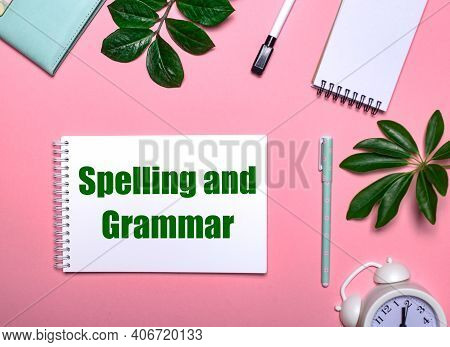 Question Spelling Ad Grammar Is Written In Green On A White Notepad On A Pink Background Surrounded