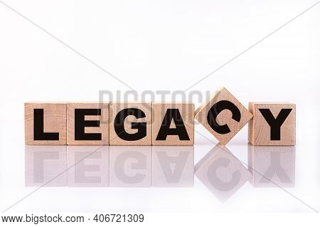 Legacy Word, Text, Written On Wooden Cubes, Building Blocks, Over White Background With Reflection.