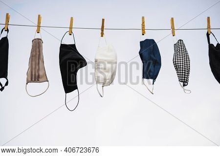Many Protective Masks Hanging On The Rope