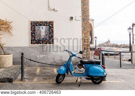 Atrani, Amalfi Coast, Campania, Italy, February 2020: Blu Scooter Vespa Parked On Old Street