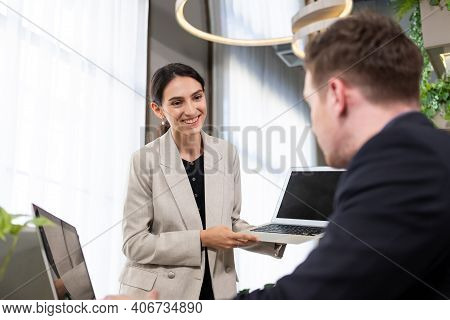 Selective Focus At Computer Screen. Caucasian Business Women Dress In Formal Suit Holding Laptop Com