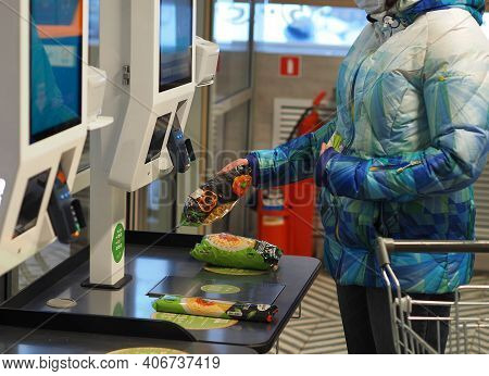 The Latest Technologies. Self-service Checkout In The Supermarket. A Woman Buys Groceries In A Super