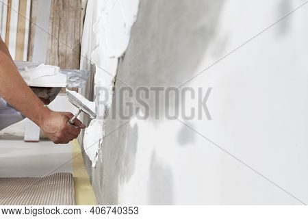 Hands Man Plasterer Construction Worker At Work With Trowel, Plaster A Wall, Closeup
