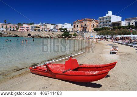 Apulia, Italy - May 30, 2017: People Visit Santa Maria Al Bagno Beach In Apulia, Italy. With 50.7 Mi