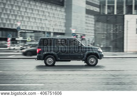 Moscow, Russia - January 29, 2021: Uaz Patriot Rides On The City Road. Russian Offroad Car Moves On