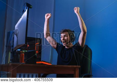 Cybersport Gamer Feel Excited While Playing In Online Cyber Sport Play, Won The Game And Cheer With