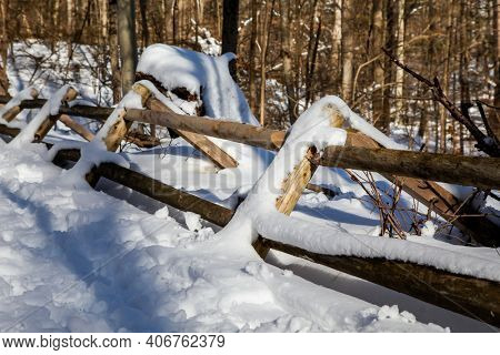 Outside fence with snow after blizzard in park