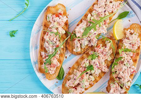 Bruschetta With Baked Salmon. Tapas. Sandwich With Salsa Of Salmon, Feta Cheese, Avocado, Tomatoes