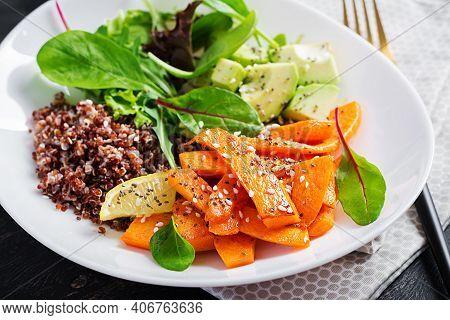 Vegan Meals, Lunch. Buddha Bowl With Quinoa, Fried Sliced Pumpkin, Avocado And Green Herbs. Vegetari