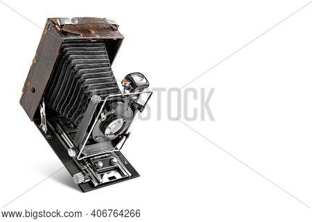 Vintage Camera On A White Background With Copy Space. Old Photo Camera In The Open State. Antique It