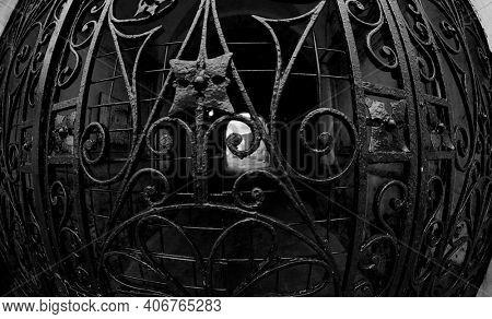 Old black lattice gate. Ancient gate