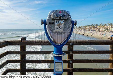 Sightseeing Retro Style Binoculars With Beach Background Oceanside Pier In San Diego, California, Us