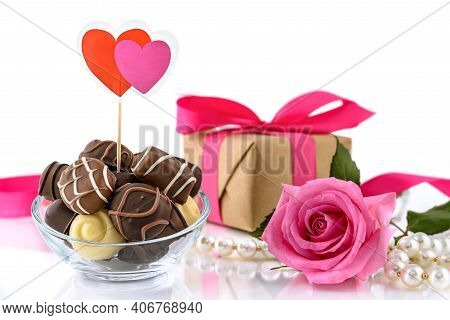 Chocolate Pralines, Gift Box, Bouquet Of Pink Roses And String Of Pearls On The White Background. Va