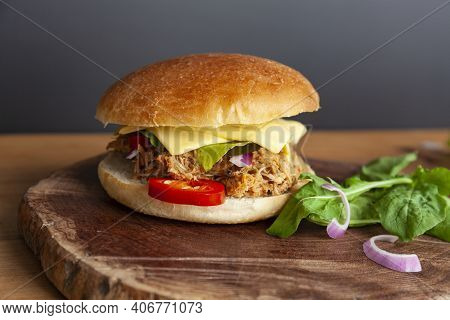 Fresh Pulled Pork Sandwich With Pickled Cucumber, Arugula And Jalapenos
