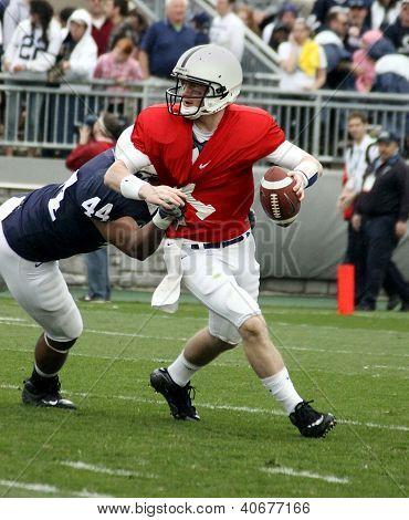 Penn State quarterback Matthew McGloin drops back