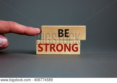 Be Strong Symbol. Wooden Blocks With Words 'be Strong'. Beautiful Grey Background. Businessman Hand.