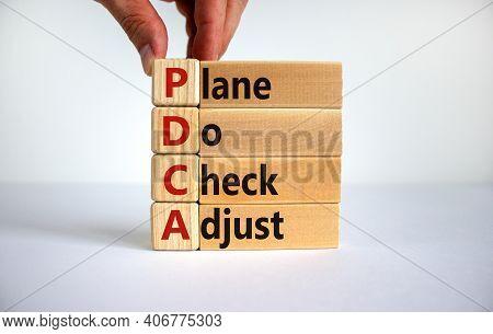 Pdca, Plan Do Check Adjust Symbol. Wooden Cubes And Blocks With Words 'pdca, Plan Do Check Adjust'.