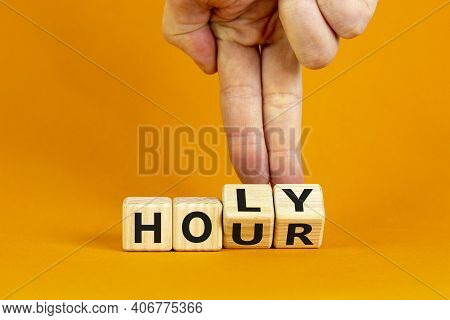 Holy Hour Symbol. Hand Turns Wooden Cubes With Words Holy Hour. Beautiful Orange Background, Copy Sp