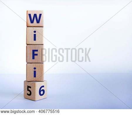Wifi 5 Or 6 Symbol. Turned A Wooden Cube And Changed The Words Wifi 5 To Wifi 6. Beautiful White Bac