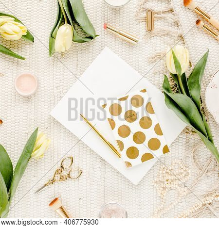 Female Workspace With Yellow Tulip Flowers, Womens Fashion Golden Accessories, Diary, Glasses On Whi