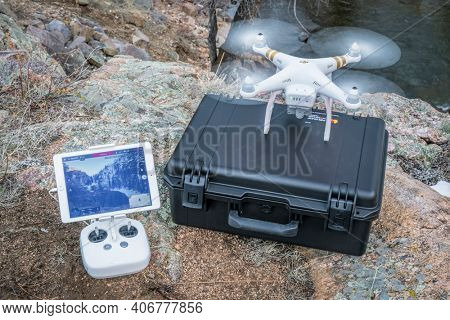 Big Narrows, Poudre Canyon, CO, USA - March 27, 2016:  DJI Phantom 3 quadcopter drone is  ready to take off in a mountain river canyon