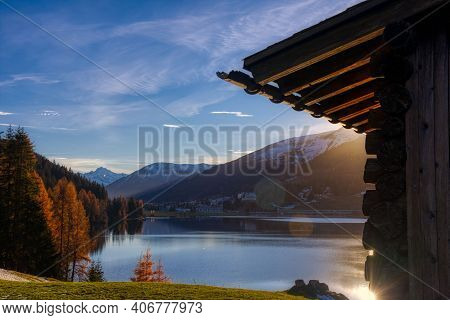 Lake Davos In Autumn. Beautiful Backlit Picture Of The Swiss Mountain Lake Landscape