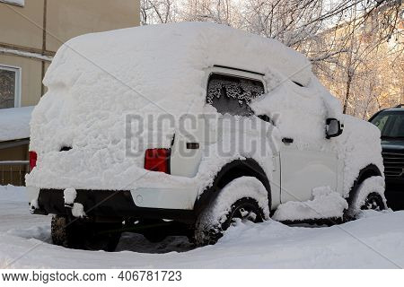 Krasnoyarsk, Russia - February 2, 2021: White Off-road Car Lada 4x4 Covered With Snow In The City St