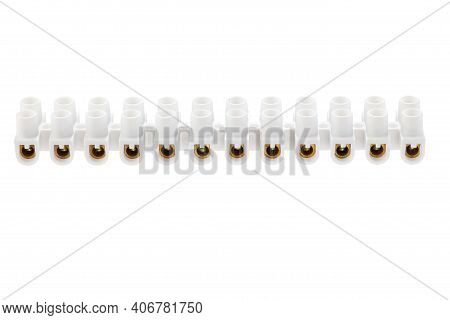 Terminal Block On 12 Contacts For Connection Of Electric Wires . Set Of White Plastic Electrical Ter