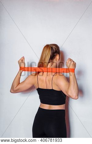 The Concept Of Sports Training At Home. The Girl Does Exercises For The Arms And Legs Using Fitness