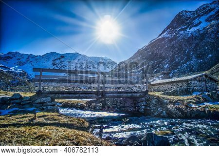 Winter Landscape With Backlight And Snow Mountains. Davos Klosters Mountains, Switzerland