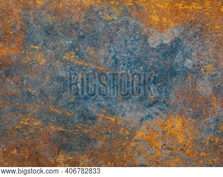 Metal Plate With Weathered Colors And Rust. Natural Light. Blue And Orange Metal Plate. Old Oxidized
