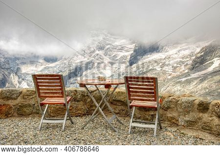 Homely Seat To Watch The Glaciers And Mountains. Mountain Hut Oberhab From La Fouly In The Val Ferre