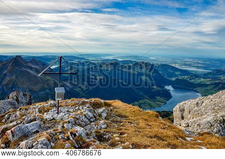 Summit Cross With View Of A Mountain Lake Wagitalersee, Photo From The Mountain Summit Mutteristock