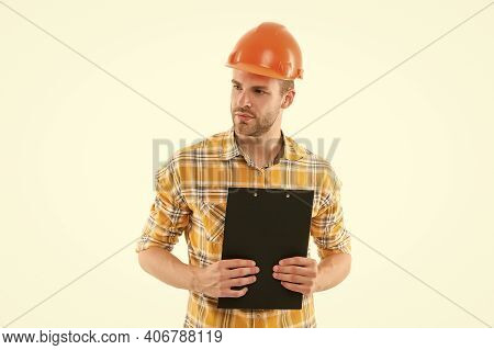Counting Finances For Renovation. Man Wear Safety Hard Hat. Redevelopment Of Home. Renovation Concep