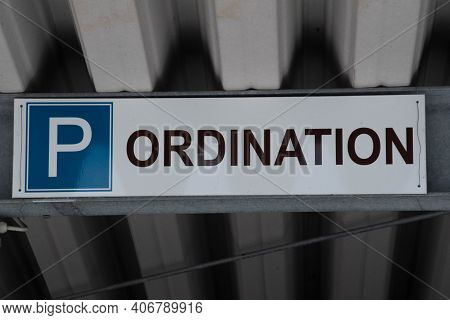 Ordination Sign In Front Of A Doctor's Office