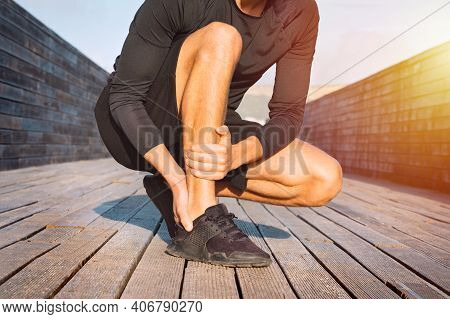 Fit Runner Suffering From Ankle Pain Or Achilles Injury. Ankle Twist Sprain Accident. Running Sport