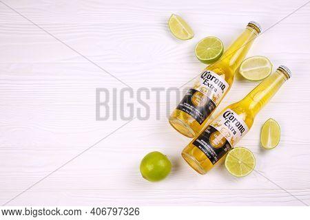 Kharkov, Ukraine - December 9, 2020: Bottles Of Corona Extra Beer With Lime Slices. Corona Produced