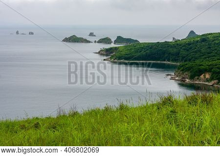 Bay Of The Sea From The Top Of A Hill Of A Mountainous Coast With An Island In The Background, Summe