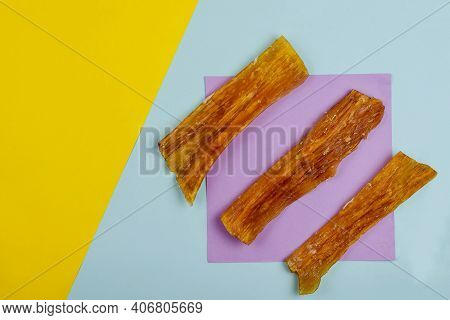 Natural Dental Treats For Dogs. Three Chew Treats. Dried Beef Tendons On A Colorful Background.  Fla