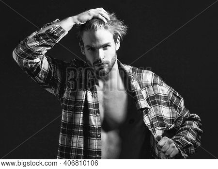 Sexy Man With Unbuttoned Shirt. Muscular Shirtless Male Model Showing Sexy Bare Torso. Metrosexual M