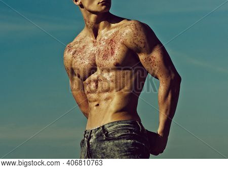 Athletic Man Pose As Hercules. Gladiator Or Atlant. Man With Muscular Wet Body. Muscular Sexy Man Wi