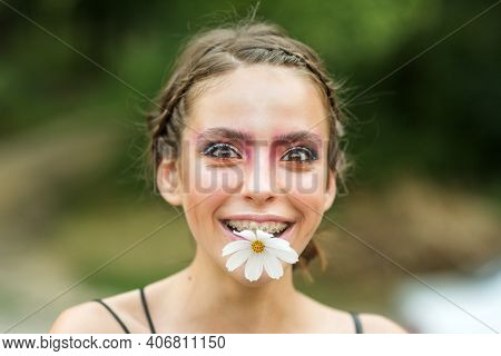 Fummy Happy Young Woman With Daisy Flower In Mouth. Beauty Spring. Springtime. Youth, Flowering Blos