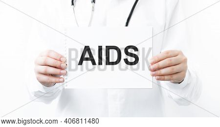 Doctor Holding Notebook With Text Aids Acquired Immunodeficiency Syndrome, Medical Concept