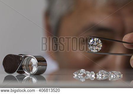Jeweller Man Looking At Round Shape Diamond. Asian Gem Dealer Inspecting Big Size Brilliant. Jewelle