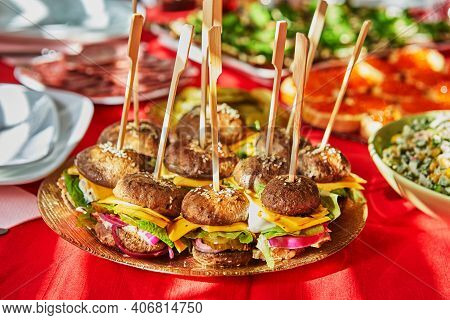 Burgers Made From Mushrooms, Cheese, Meat And Cucumbers. Healthy Food, No Bread